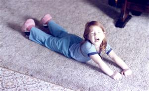 Ms. Grant when she was 3.5 years old throwing a temper tantrum.