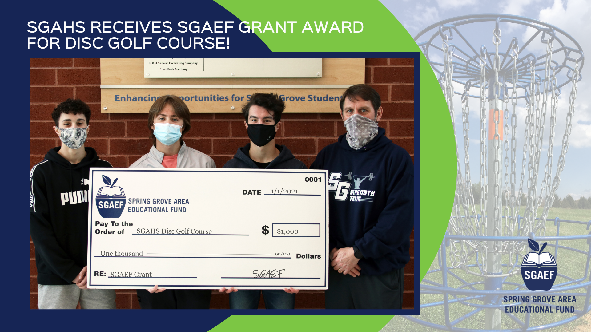 Group of three high school students with teacher posing for picture with large SGAEF check.