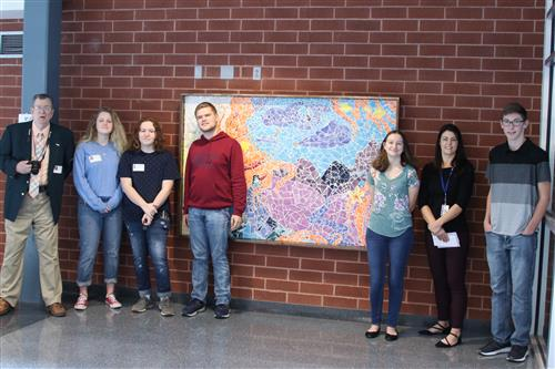Students in with art mosaic
