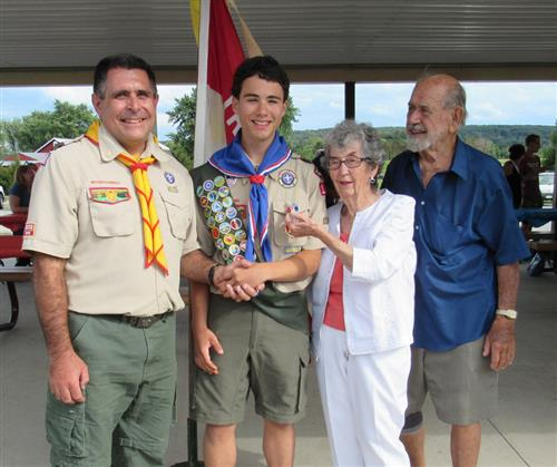 Wyatt Stambaugh with his grandparents receiving his Eagle Scout Award