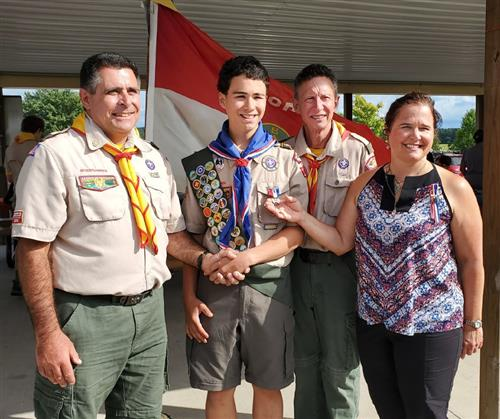 Wyatt Stambaugh with family while receiving Eagle Scout Award